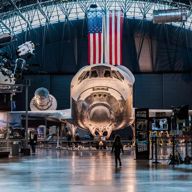 @abroadwife - Child standing in front of Space Shuttle Discovery at the Udvar-Hazy Air and Space Museum - Free Smithsonian museum near Washington, DC