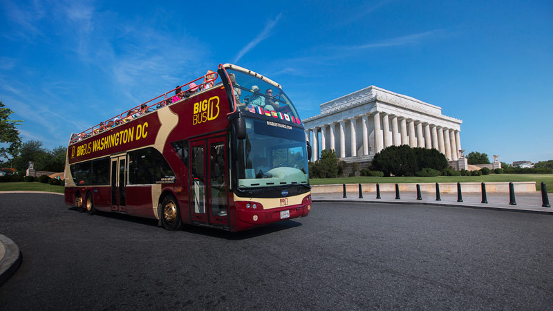 Big Bus tour in front of Lincoln Memorial - Eco-friendly group tour options in Washington, DC
