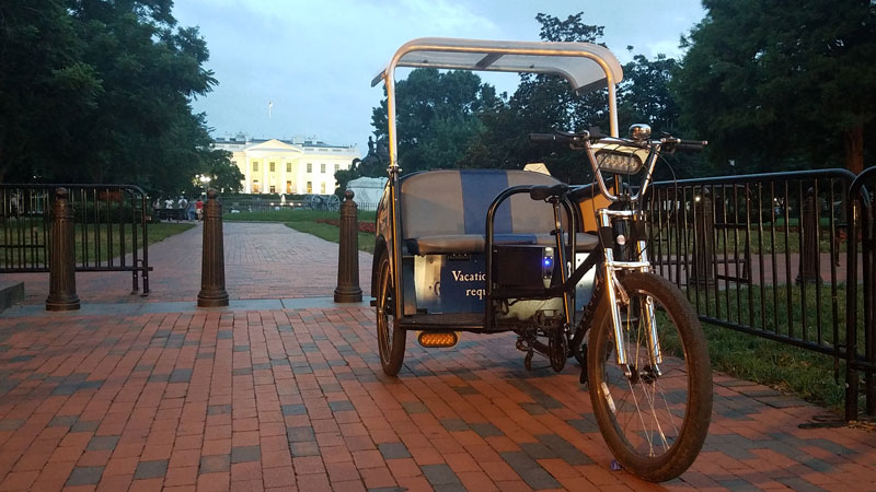 Adventure DC Tricycle Tours vehicle in front of White House - Eco-friendly tours in Washington, DC