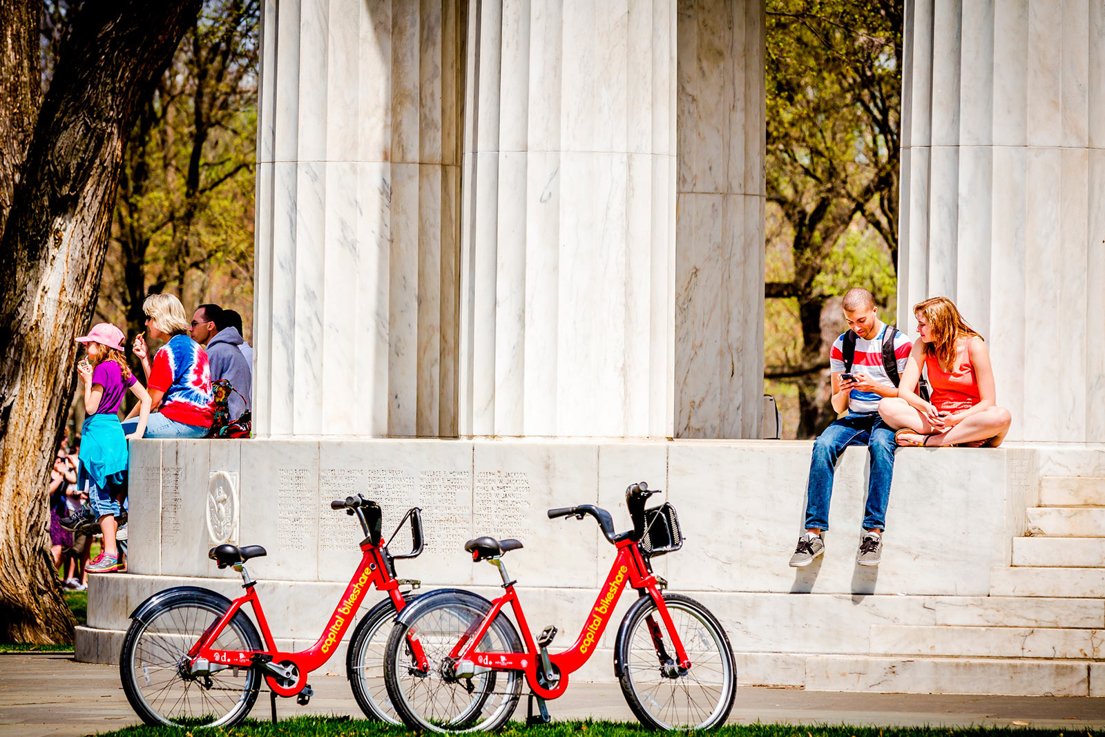 Couple with Capital Bikeshare Bikes at DC War Memorial - Washington, DC