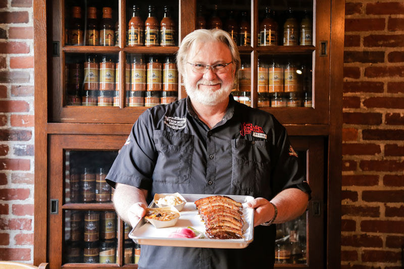 Celebrity chef Myron Mixon with barbecue plate - Where to eat in historic Old Town Alexandria