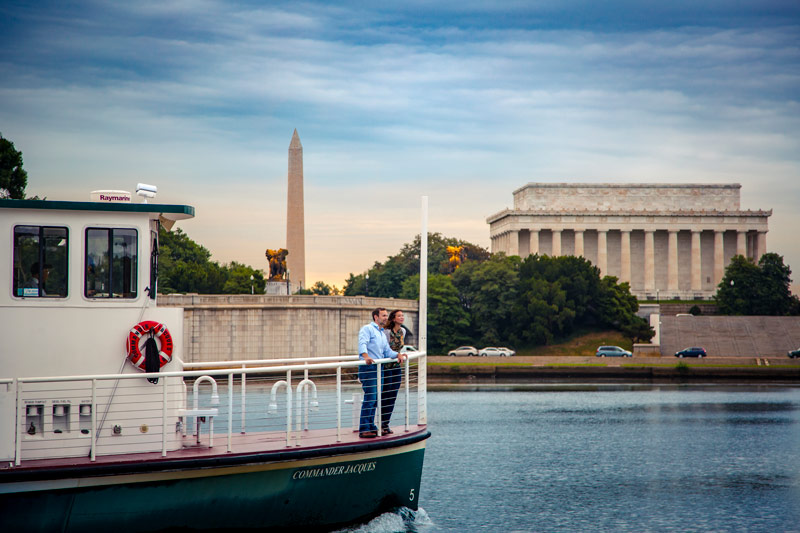Couple on water taxi in Potomac River by Lincoln Memorial - Waterfront things to do in and around Washington, DC