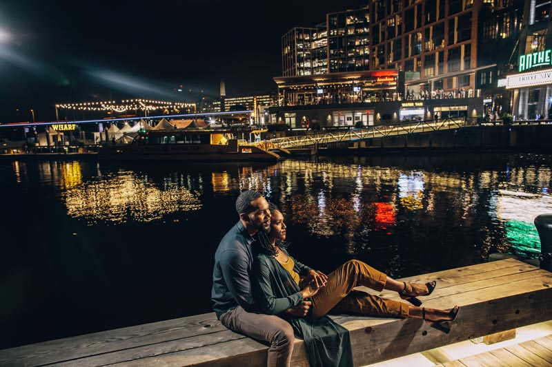 Couple sitting by The Wharf pier at night - The best things to see and do in Washington, DC