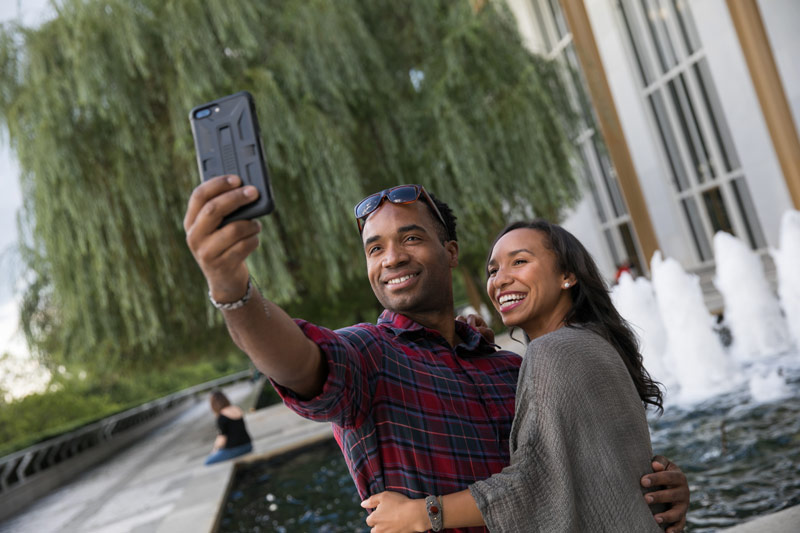 Couple taking selfie on Kennedy Center Terrace - Romantic spots in Washington, DC