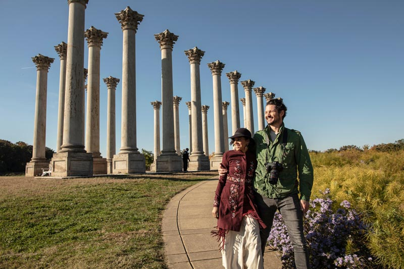 Couple walking by the National Capitol Columns at the National Arboretum - Public park and attraction in Washington, DC