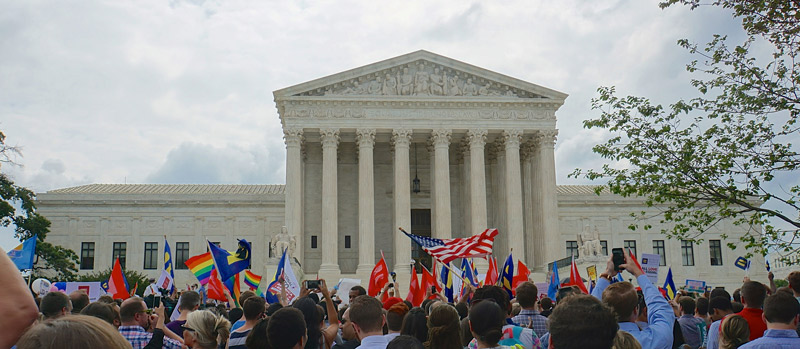 Crowd in front of United States Supreme Court in Washington, DC celebrating decision legalizing gay marriage in the United States