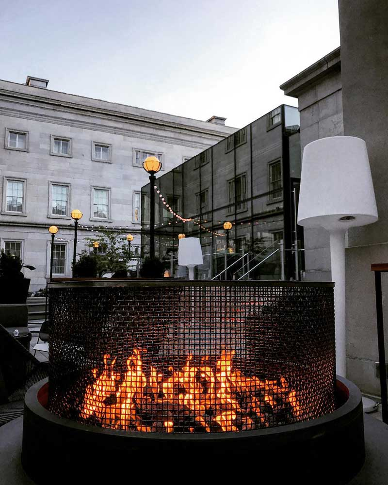 @laurenstafford_dcre - Outdoor fire pit on Dirty Habit's patio - Cozy bars and restaurants in Washington, DC