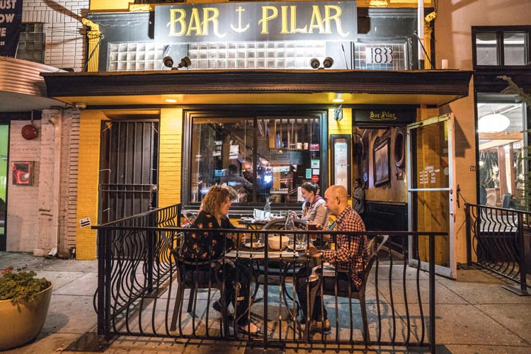 Nighttime diners at Bar Pilar patio on 14th Street - Places to Eat in Washington, DC