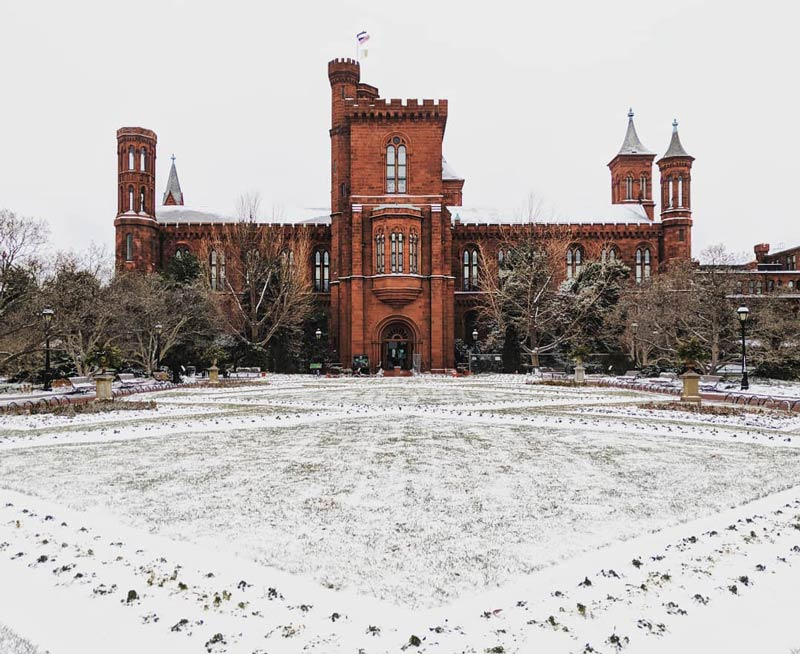 @ekelly80 - Snowy winter scene at the Smithsonian Castle on the National Mall - Winter in Washington, DC