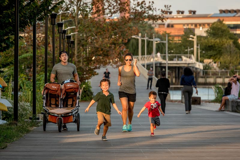 Family running along Anacostia Riverwalk Trail - Outdoor exercise and trails in Washington, DC