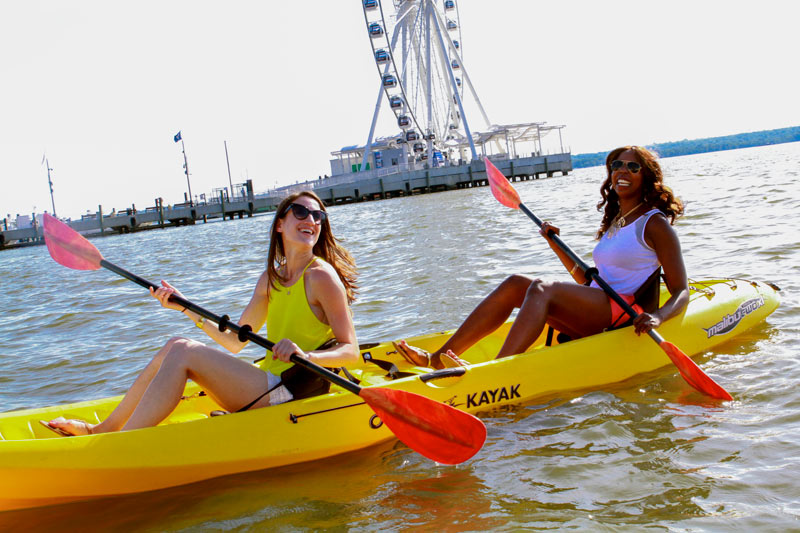 Friends boating at National Harbor - Waterfront activities at National Harbor near Washington, DC