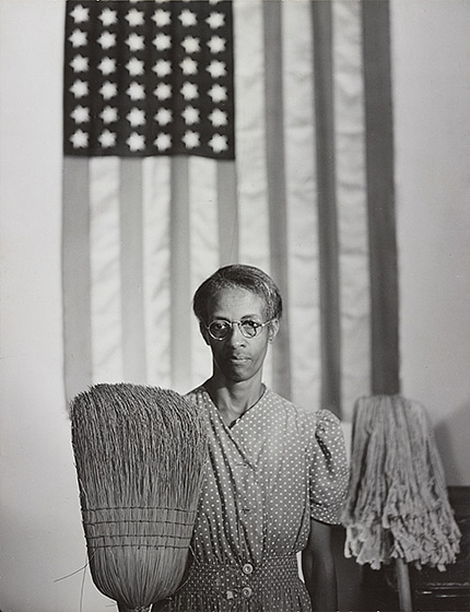 The exhibit features Parks' famous series of photographs of Ella Watson, including American Gothic, Washington, D.C.
