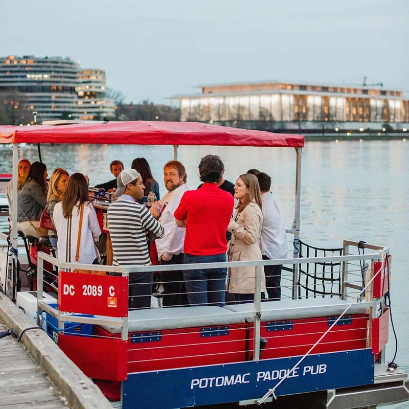 Guests on the Potomac Paddle Pub boat in Georgetown - Things to do on the Georgetown waterfront in DC