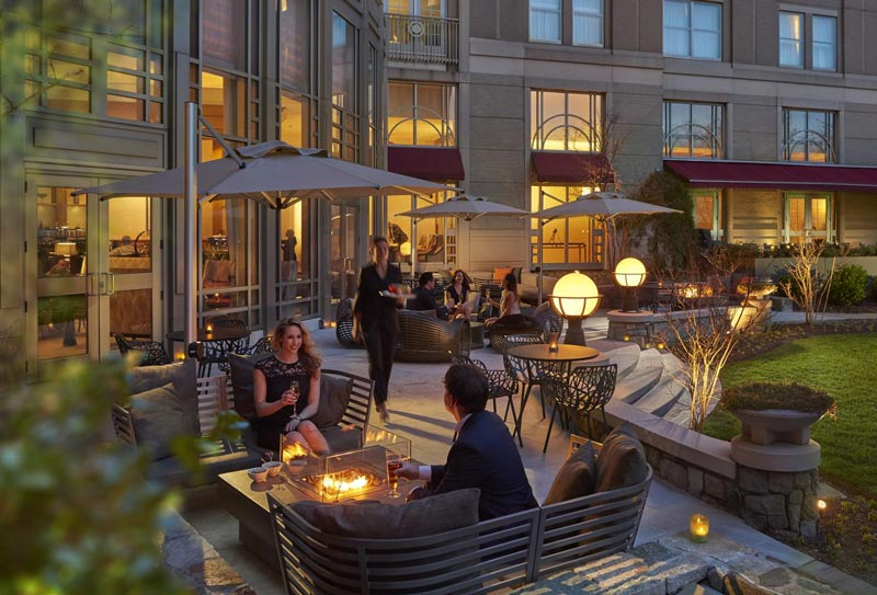 Guests by the fire pit at the Mandarin Oriental - Fall and winter hotel deals in Washington, DC