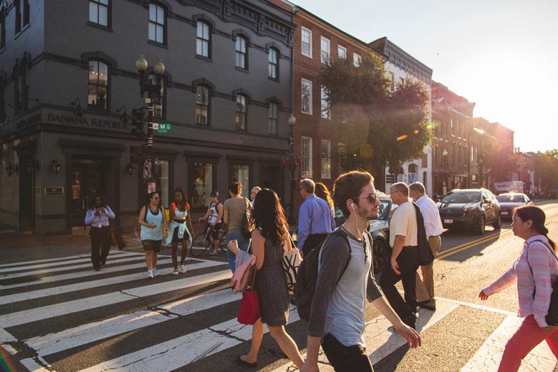 Walking across M Street NW in Georgetown - The best ways to get around Washington, DC