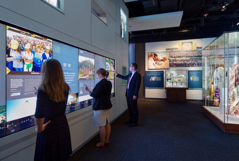 Visitors using interactive display at the Saint John Paul II National Shrine - Things to do in DC's Brookland neighborhood