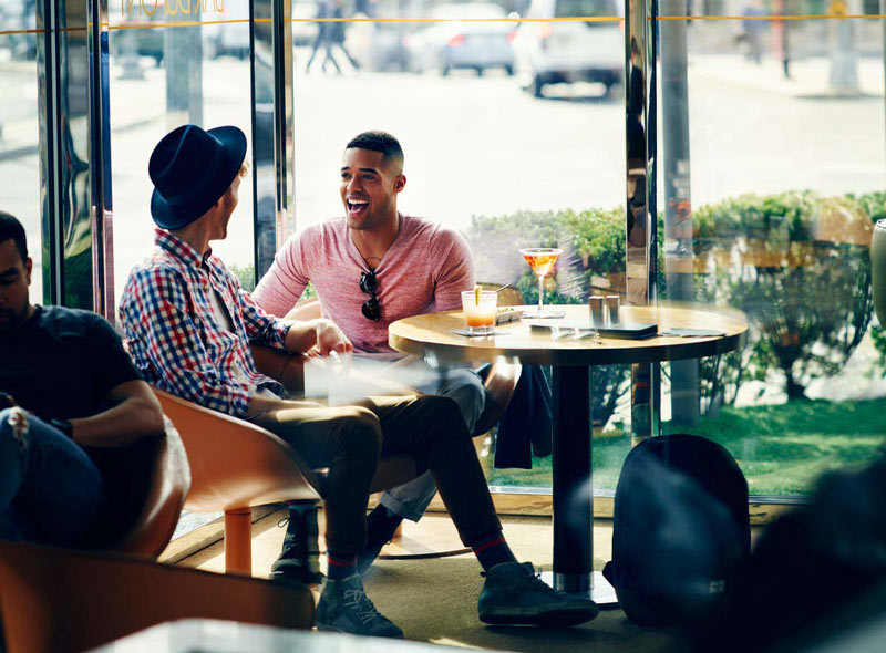LGBTQ couple drinking at The Dupont Circle Hotel - Things to do for couples in Washington, DC