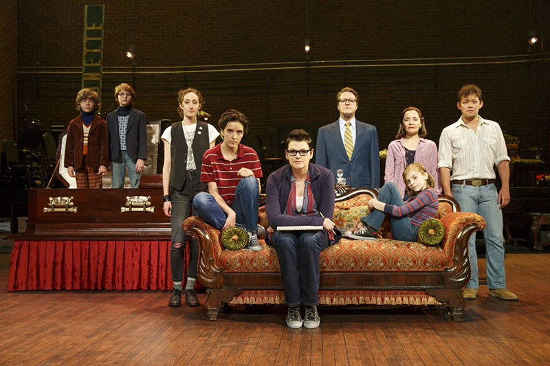 Fun Home Play cast sitting on the stage looking at the camera