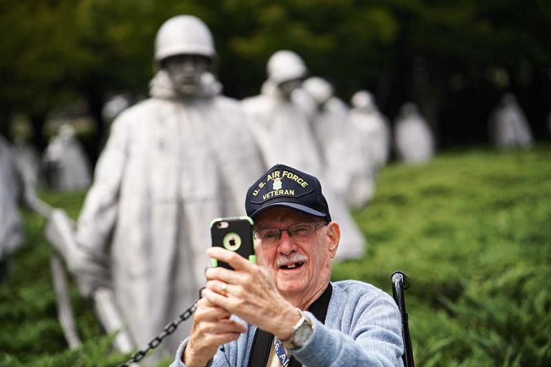 @mikijourdan - U.S. veteran on Honor Flight taking selfie in front of Korean War Veterans Memorial - The National Mall in Washington, DC