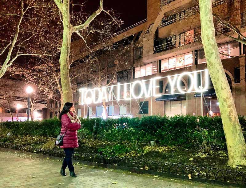 @miyosmmm - Woman in front of Georgetown GLOW light installation - Holiday events and things to do in Washington, DC