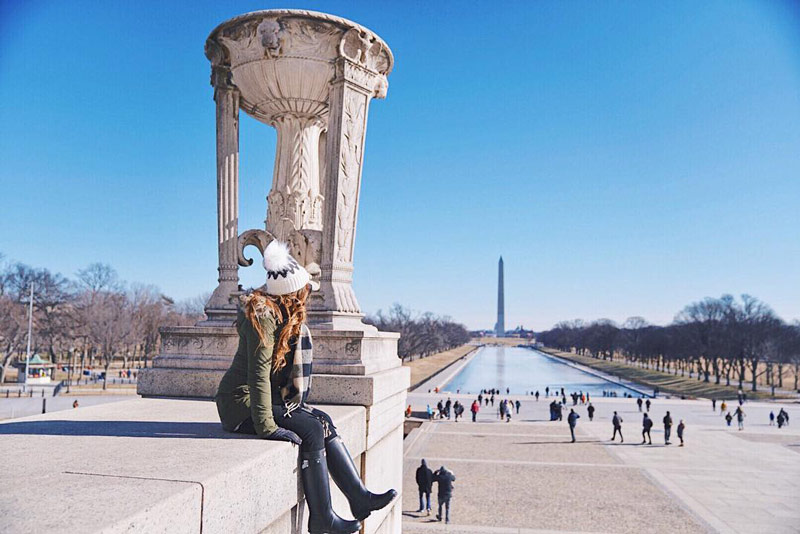 @paulineayo - Visitor at Lincoln Memorial in winter overlooking the National Mall - Memorials in Washington, DC