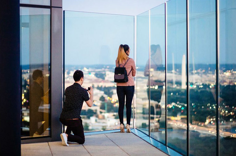 @polyakov.photography - Man proposing at the top of the Observation Deck at CEB Tower - Romantic rooftop spots in and around Washington, DC