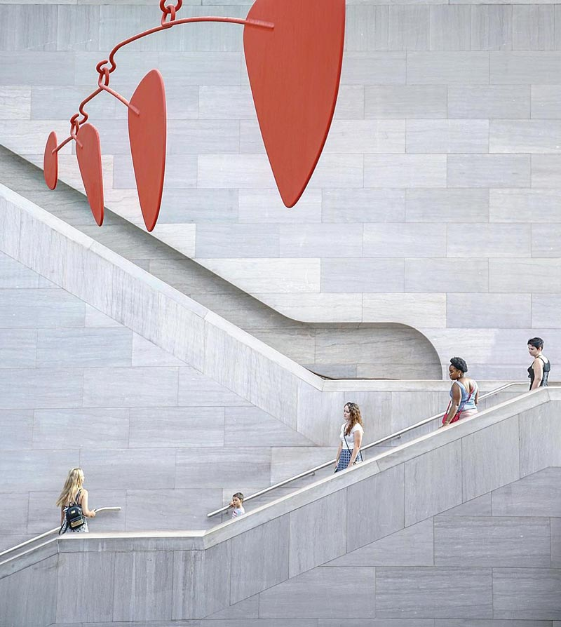 @pootie_ting - Visitors on stairs at the National Gallery of Art East Building - Free modern art museum in Washington, DC