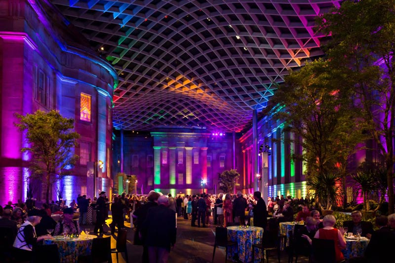 Rainbow-colored evening event at the Smithsonian American Art Museum's Kogod Courtyard in Washington, DC