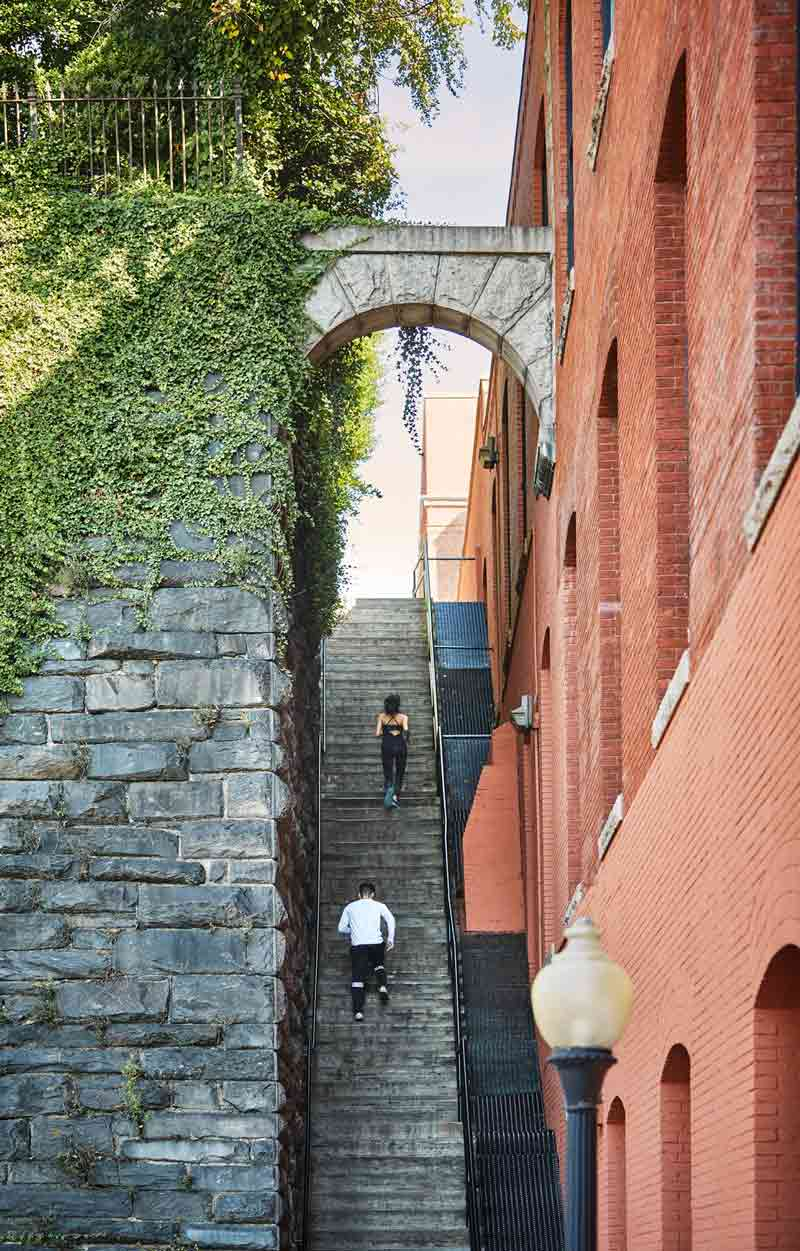 Runners going up The Exorcist Steps in Georgetown - Free outdoor activity and landmark in Washington, DC