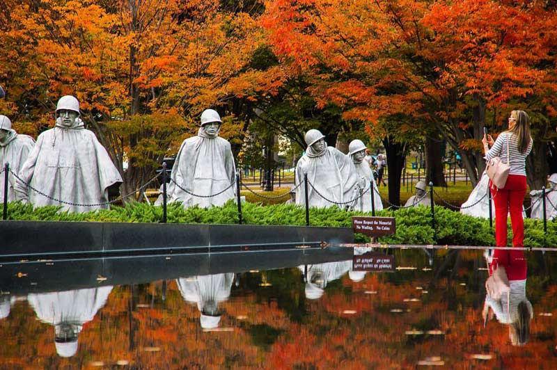 @sinhat25 - Woman taking photo of Korean War Veterans Memorial - Fall foliage in Washington, DC