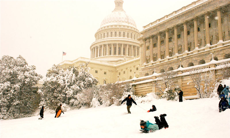 Sledding on Capitol Hill in front of the U.S. Capitol - Snow day activities in Washington, DC