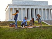 Family picnicking on National Mall by Lincoln Memorial
