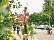 Visitors walking by the Smithsonian Castle on the National Mall in Washington, DC