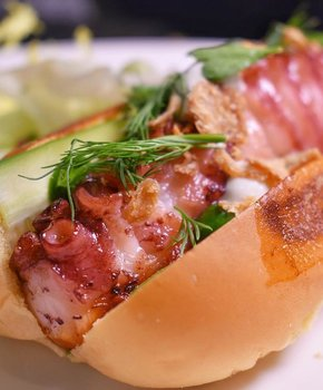 @choisauceboss - Charred octopus hot dog at Brothers and Sisters in The LINE Hotel - Popular restaurant in Adams Morgan DC