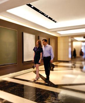 couple walking in a four seasons hotel hallway
