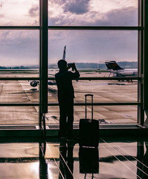 Traveler taking photo of plane at Washington Reagan National Airport - Airports near Washington, DC