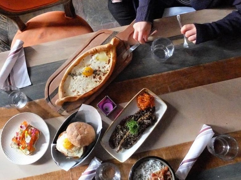 Diner with full spread at Compass Rose Bar + Kitchen - Restaurant in Washington, DC