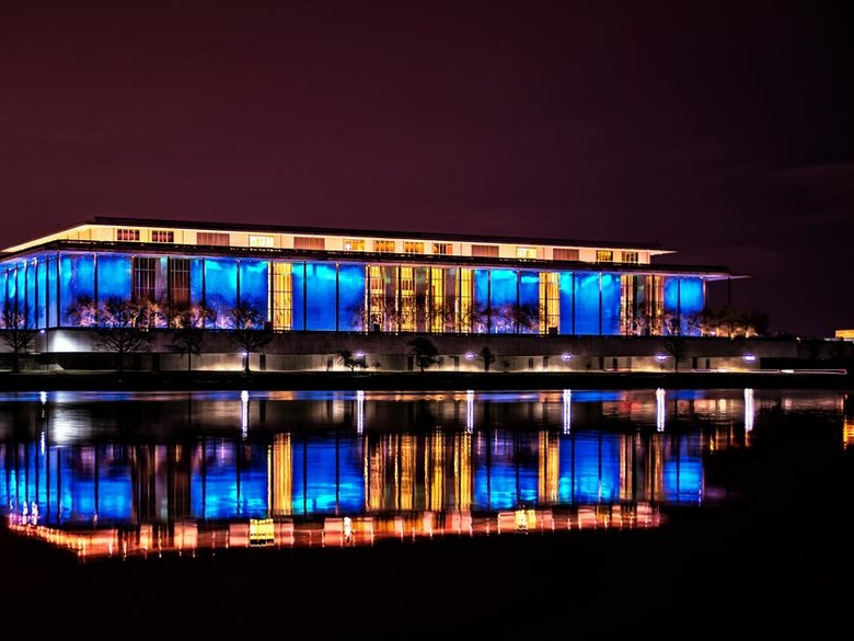 Kennedy Center at night over Potomac River