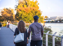 Couple walking along theGeorgetown Waterfront - Romantic spots in Washington, DC