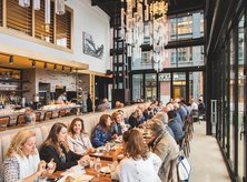 Diners at Requin by Mike Isabella on the Southwest Waterfront - Restaurant at The Wharf in Washington, DC