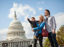 family in front of capitol building