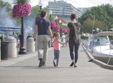 Family walking along Potomac River at the Georgetown Waterfront