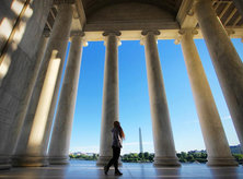 @ms.lechonkawali - Visitor at Jefferson Memorial looking out at Washington Monument across Tidal Basin - Memorials and monuments in Washington, DC