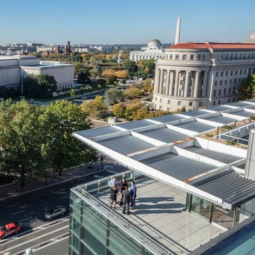 Meeting taking place on the Newseum terrace overlooking Washington, DC's museums and more