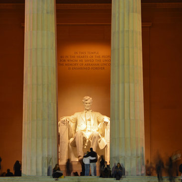 Couple viewing the Lincoln Memorial at night on the National Mall - Budget-friendly date idea in Washington, DC