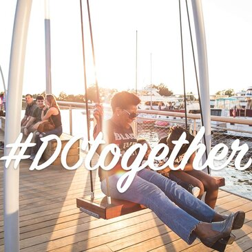Family on a swing at The Wharf | #DCtogether Thumb