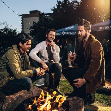 Friends around the fire at Wundergarten beer garden in NoMa - The best beer gardens in Washington, DC