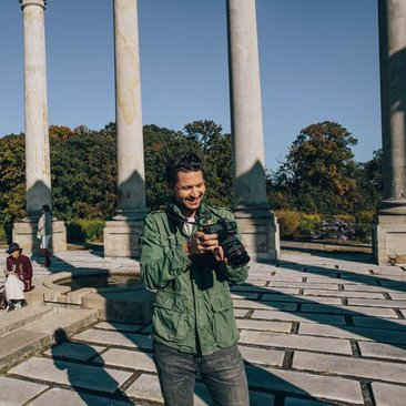 Man taking photographs of the National Arboretum National Capitol Columns - The most Instagrammable places in Washington, DC