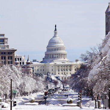 Capitol Building in the winter covered in snow