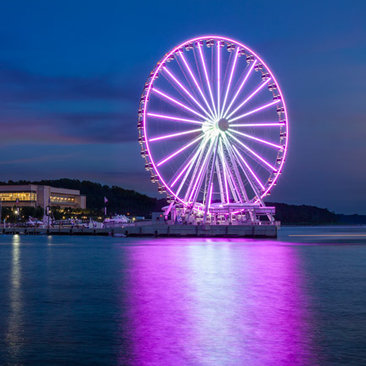National Harbor shops and Capital Wheel at night - Waterfront things to do in Maryland near Washington, DC